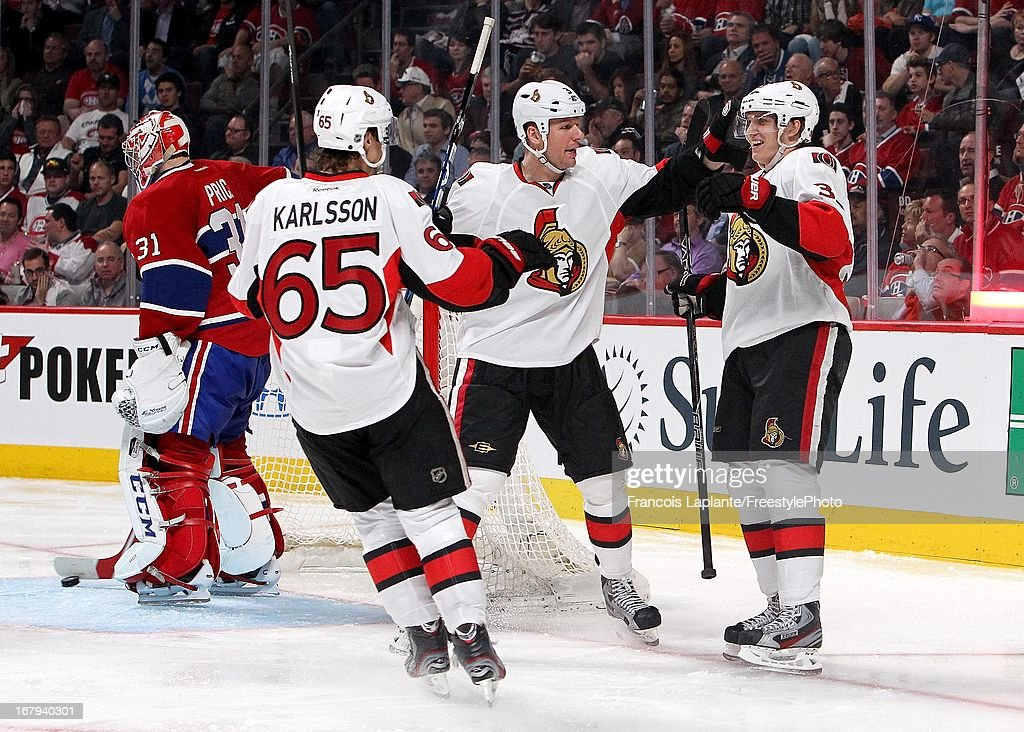 Jakob Silfverberg #33 of the Ottawa Senators celebrates his third period goal with teammates Marc Methot #3 and Erik Karlsson #65 in Game One of the Eastern Conference Quarterfinal during the 2013 NHL Stanley Cup Playoffs at the Bell Centre on May 2, 2013 in Montreal, Quebec, Canada.