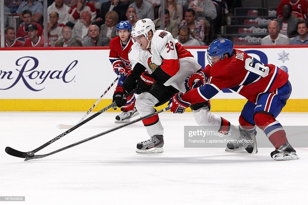 Jakob Silfverberg #33 of the Ottawa Senators controls the puck as Raphael Diaz #61 of the Montreal Canadiens poke checks in Game One of the Eastern Conference Quarterfinal during the 2013 NHL Stanley Cup Playoffs at the Bell Centre on May 2, 2013 in Montreal, Quebec, Canada.