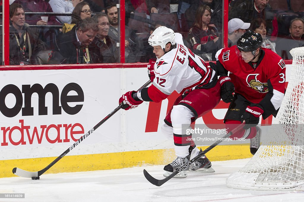 Jakob Silfverberg #33 of the Ottawa Senators defends against a puck carrying Eric Staal #12 of the Carolina Hurricanes during an NHL game at Scotiabank Place on February 7, 2013 in Ottawa, Ontario, Canada.