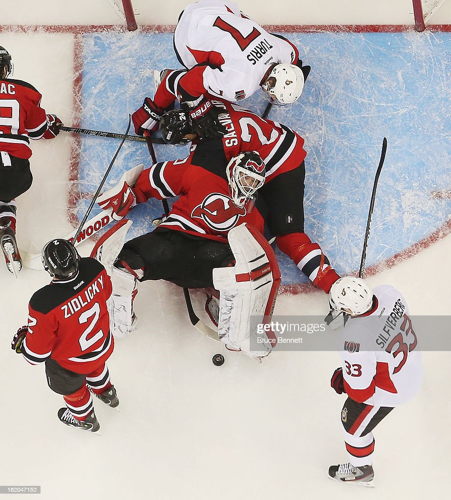 Jakob Silfverberg #33 of the Ottawa Senators looks for a rebound as <a gi-track='captionPersonalityLinkClicked' href=/galleries/search?phrase=Martin+Brodeur&family=editorial&specificpeople=201594 ng-click='$event.stopPropagation()'>Martin Brodeur</a> #30 of the New Jersey Devils looses the puck at the Prudential Center on February 18, 2013 in Newark, New Jersey. The Senators defeated the Devils 2-1 in the shootout.
