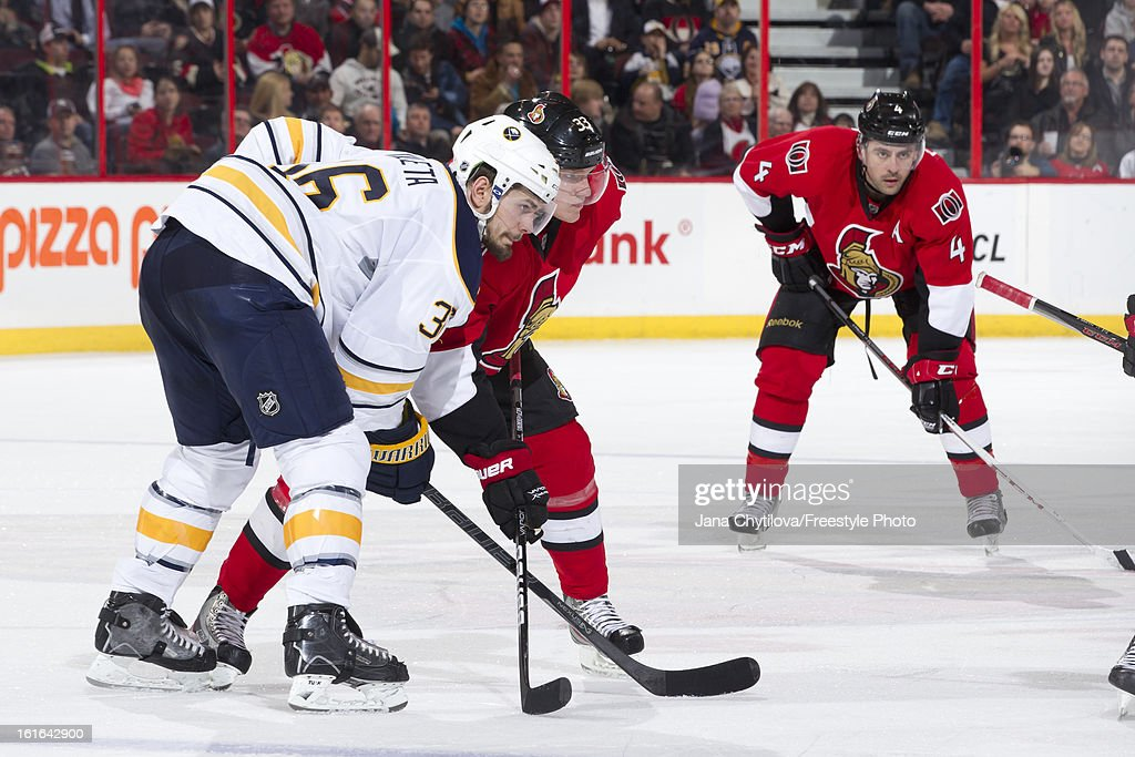 Jakob Silfverberg of the Ottawa Senators prepares for a faceoff against Patrick Kaleta of the Buffalo Sabres during an NHL game at Scotiabank Place...