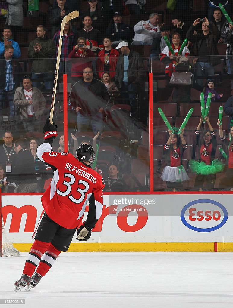 Jakob Silfverberg #33 of the Ottawa Senators raises his stick as he is named a star of the game after a two-goal performance against the Winnipeg Jets on March 17, 2013 at Scotiabank Place in Ottawa, Ontario, Canada.