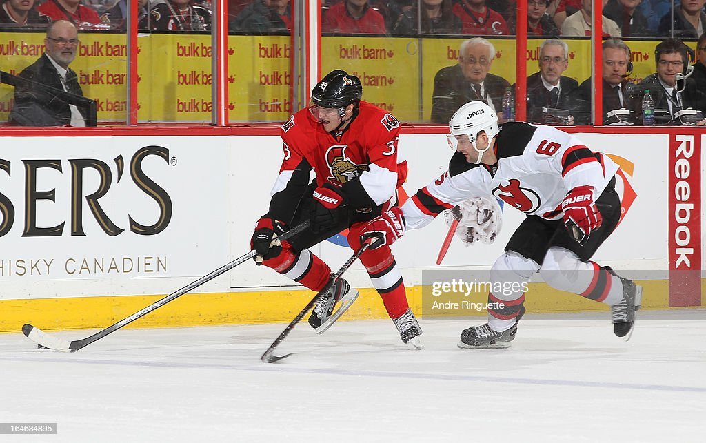 Jakob Silfverberg #33 of the Ottawa Senators skates the puck wide of Andy Greene #6 of the New Jersey Devils on March 25, 2013 at Scotiabank Place in Ottawa, Ontario, Canada.
