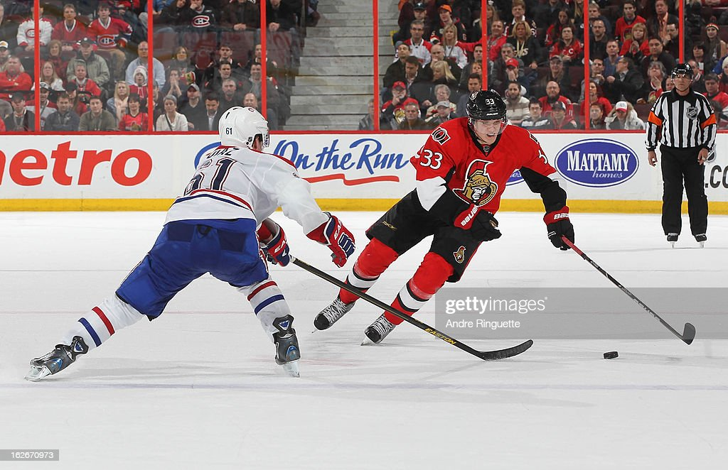 Jakob Silfverberg #33 of the Ottawa Senators stickhandles the puck against <a gi-track='captionPersonalityLinkClicked' href=/galleries/search?phrase=Raphael+Diaz&family=editorial&specificpeople=5333791 ng-click='$event.stopPropagation()'>Raphael Diaz</a> #61 of the Montreal Canadiens on February 25, 2013 at Scotiabank Place in Ottawa, Ontario, Canada.