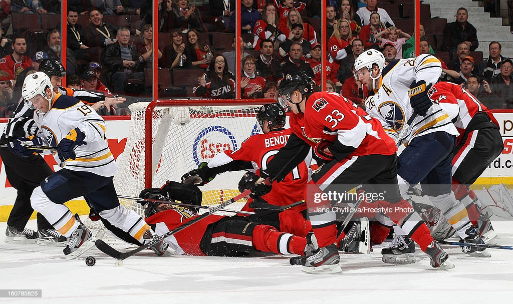 Jakob Silfverberg #33 of the Ottawa Senators tips the puck away from <a gi-track='captionPersonalityLinkClicked' href=/galleries/search?phrase=Cody+Hodgson&family=editorial&specificpeople=4151192 ng-click='$event.stopPropagation()'>Cody Hodgson</a> #19 of the Buffalo Sabres as a scramble ensues, during an NHL game at Scotiabank Place on February 5, 2013 in Ottawa, Ontario, Canada.