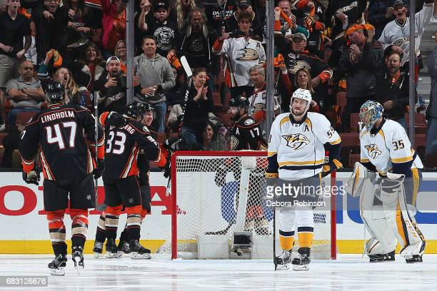 Jakob Silfverberg Rickard Rakell and Hampus Lindholm of the Anaheim Ducks celebrate a goal in the second period against Roman Josi and Pekka Rinne of...