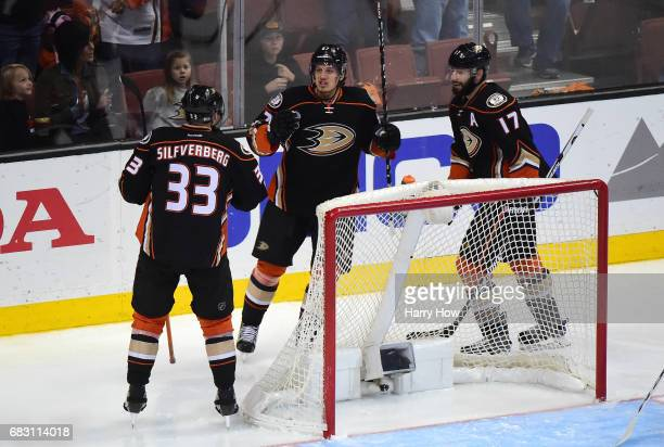 Jakob Silfverberg Rickard Rakell and Ryan Kesler of the Anaheim Ducks celebrate Silfverberg's goal in the second period of Game Two of the Western...