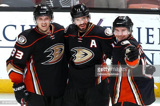 Jakob Silfverberg Ryan Kesler and Sami Vatanen of the Anaheim Ducks celebrate a second period goal against the Nashville Predators on October 26 2016...