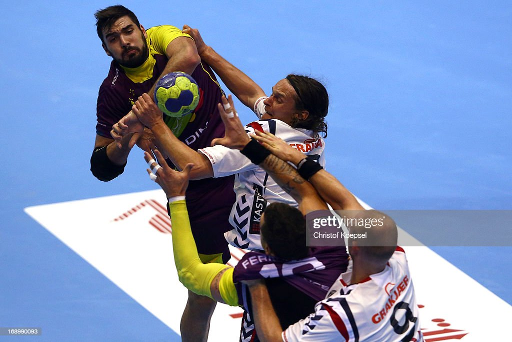 Jakob Thoustrup (2nd L) of Holstebro and Soeren Soerensen of Holstebro (R) defend against Jorge Maqueda Pena of Nantes (L) during the EHF Cup Semi Final match between Tvis Holstebro and HBC Nantes at Palais des Sports de Beaulieu on May 18, 2013 in Nantes, France.