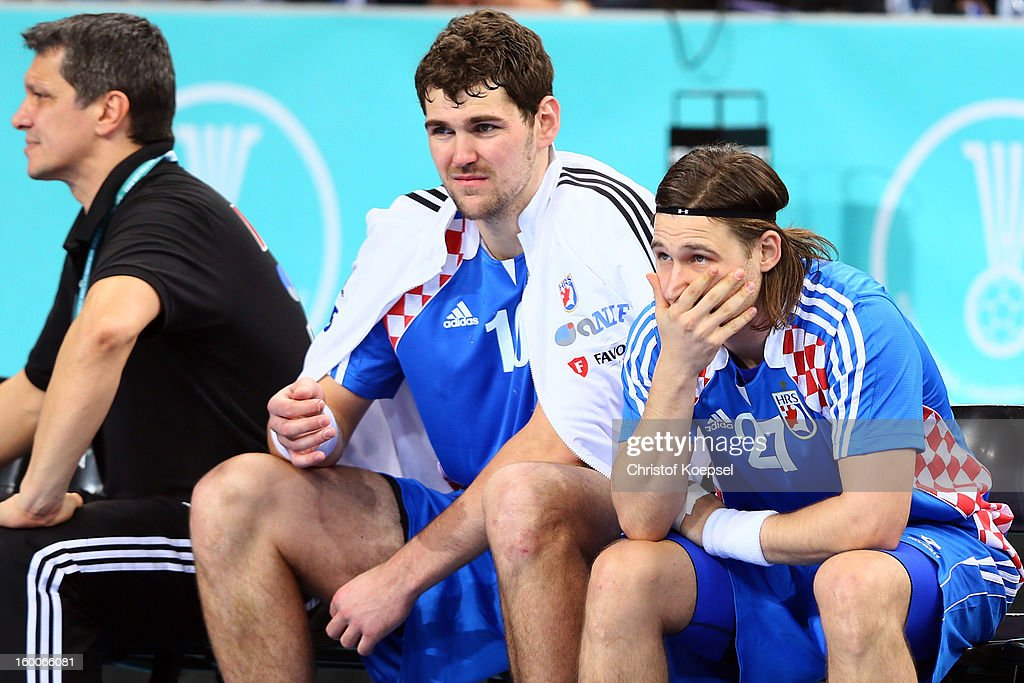 Jakov Gojun and Ivan Cupic of Croatia look dejected during Men's Handball World Championship 2013 semi final match between Denmark and Croatia at...