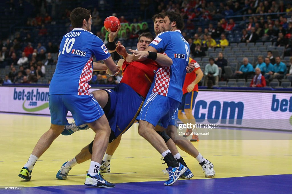 Jakov Gojun of Croatia (L) and <a gi-track='captionPersonalityLinkClicked' href=/galleries/search?phrase=Igor+Vori&family=editorial&specificpeople=784502 ng-click='$event.stopPropagation()'>Igor Vori</a> of Croatia (R) defend against Julen Aguinagalde of Spain (C) during the Men's European Handball Championship bronze medal match between Croatia and Spain at Beogradska Arena on January 29, 2012 in Belgrade, Serbia.