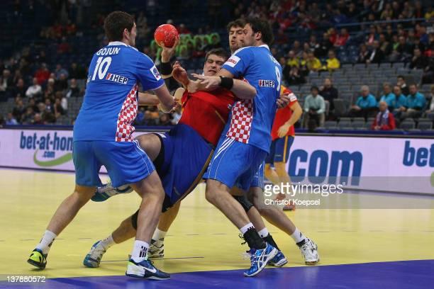 Jakov Gojun of Croatia and Igor Vori of Croatia defend against Julen Aguinagalde of Spain during the Men's European Handball Championship bronze...
