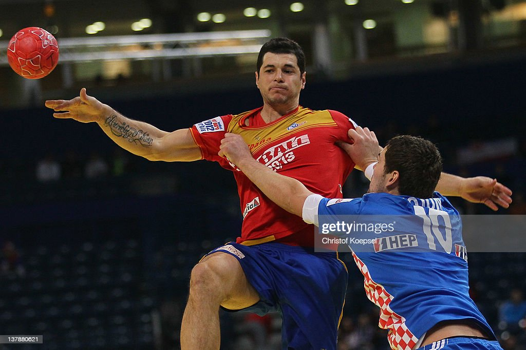 Jakov Gojun of Croatia (R) defends against <a gi-track='captionPersonalityLinkClicked' href=/galleries/search?phrase=Alberto+Entrerrios&family=editorial&specificpeople=727583 ng-click='$event.stopPropagation()'>Alberto Entrerrios</a> of Spain (L) during the Men's European Handball Championship bronze medal match between Croatia and Spain at Beogradska Arena on January 29, 2012 in Belgrade, Serbia.
