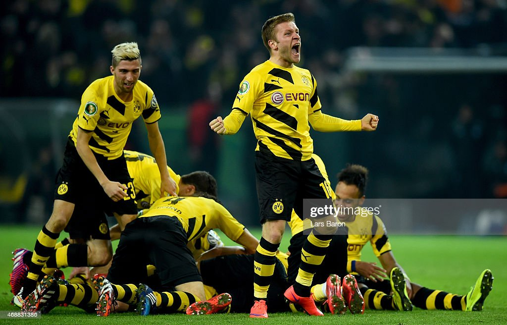 <a gi-track='captionPersonalityLinkClicked' href=/galleries/search?phrase=Jakub+Blaszczykowski&family=editorial&specificpeople=2290714 ng-click='$event.stopPropagation()'>Jakub Blaszczykowski</a> of Borussia Dortmund celebrates after team mate <a gi-track='captionPersonalityLinkClicked' href=/galleries/search?phrase=Sebastian+Kehl&family=editorial&specificpeople=486611 ng-click='$event.stopPropagation()'>Sebastian Kehl</a> scored his teams third goal during the DFB Cup Quarter Final match between at Borussia Dortmund and 1899 Hoffenheim at Signal Iduna Park on April 7, 2015 in Dortmund, Germany.