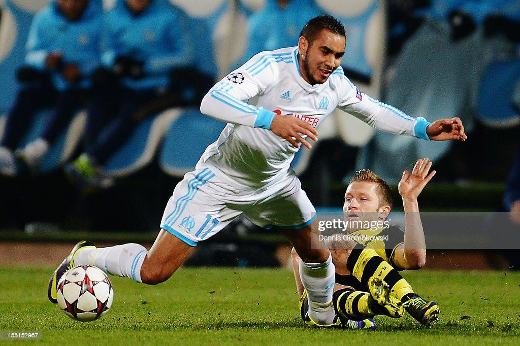 Jakub Blaszczykowski of Borussia Dortmund challenges Dimitri Payet of Olympique de Marseille during the UEFA Champions League Group F match between...