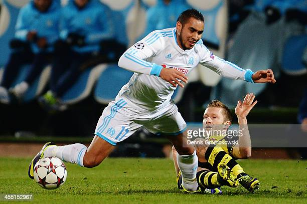 Jakub Blaszczykowski of Borussia Dortmund challenges Dimitri Payet of Olympique de Marseille during the UEFA Champions League Group F match between...