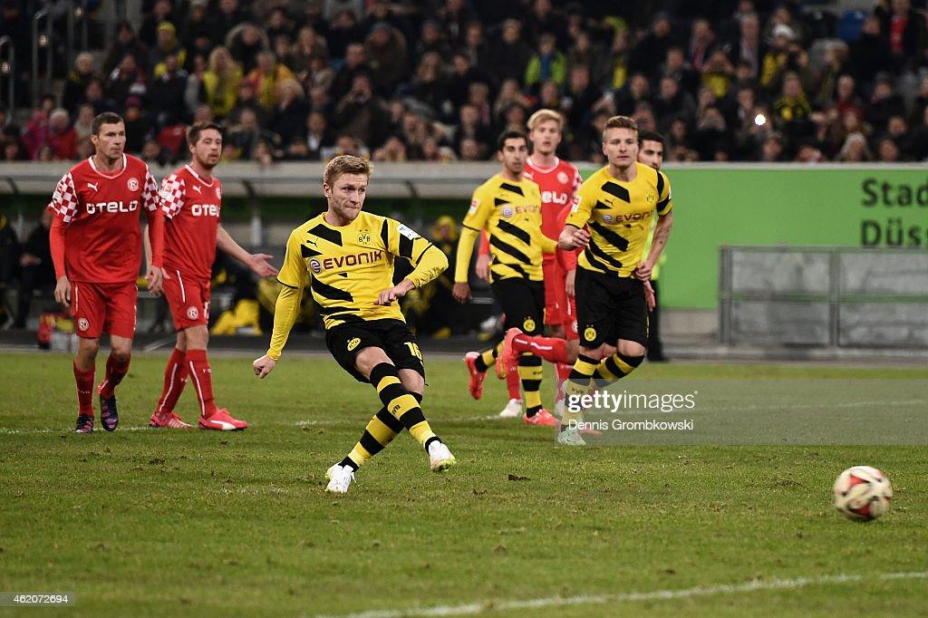 Jakub Blaszczykowski of Borussia Dortmund scores their first goal during the friendly match between Fortuna Duesseldorf and Borussia Dortmund at...
