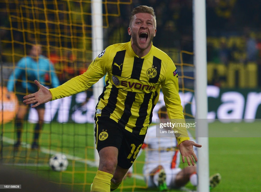 <a gi-track='captionPersonalityLinkClicked' href=/galleries/search?phrase=Jakub+Blaszczykowski&family=editorial&specificpeople=2290714 ng-click='$event.stopPropagation()'>Jakub Blaszczykowski</a> of Dortmund celebrates after scoring his teams third goal during the UEFA Champions League round of 16 second leg match between Borussia Dortmund and Shakhtar Donetsk at Signal Iduna Park on March 5, 2013 in Dortmund, Germany.