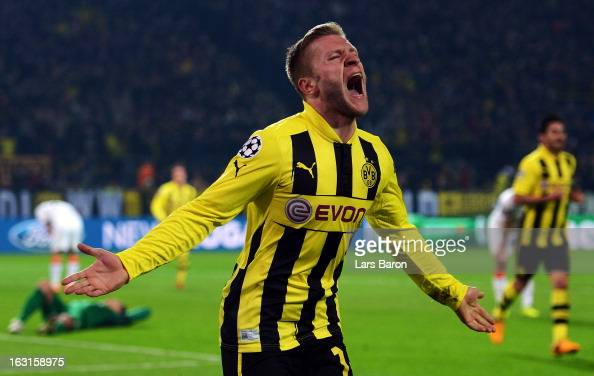 Jakub Blaszczykowski of Dortmund celebrates after scoring his teams third goal during the UEFA Champions League round of 16 second leg match between...