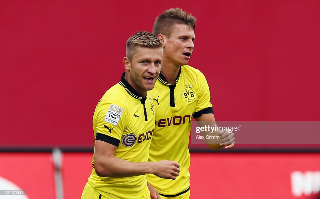 <a gi-track='captionPersonalityLinkClicked' href=/galleries/search?phrase=Jakub+Blaszczykowski&family=editorial&specificpeople=2290714 ng-click='$event.stopPropagation()'>Jakub Blaszczykowski</a> (front) of Dortmund celebrates his team's first goal with team mate <a gi-track='captionPersonalityLinkClicked' href=/galleries/search?phrase=Lukasz+Piszczek&family=editorial&specificpeople=4380352 ng-click='$event.stopPropagation()'>Lukasz Piszczek</a> during the Bundesliga match between 1. FC Nuernberg and Borussia Dortmund at Easy Credit Stadium on September 1, 2012 in Nuremberg, Germany.