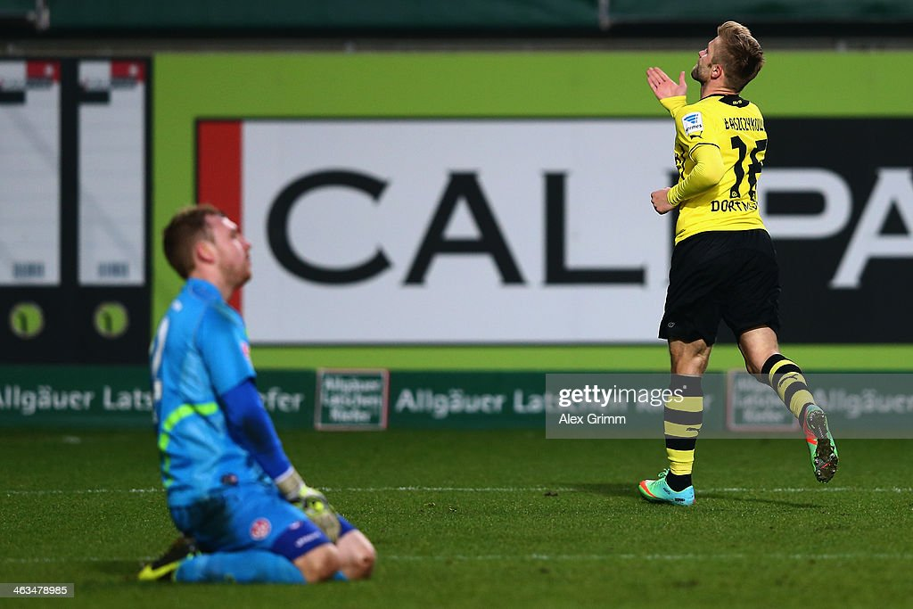 Jakub Blaszczykowski of Dortmund celebrates his team's second goal as goalkeeper David Hohs of Kaiserslautern reacts during the friendly match...