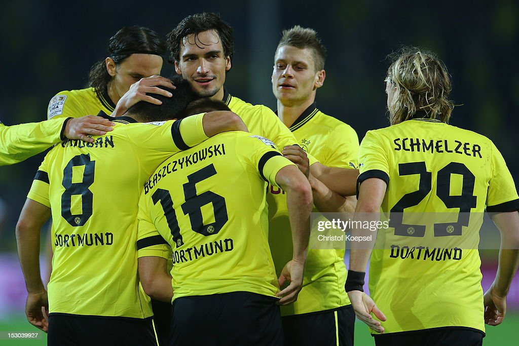 <a gi-track='captionPersonalityLinkClicked' href=/galleries/search?phrase=Jakub+Blaszczykowski&family=editorial&specificpeople=2290714 ng-click='$event.stopPropagation()'>Jakub Blaszczykowski</a> of Dortmund celebrates the fifth goal with his team mates during the Bundesliga match between Borussia Dortmund and VfL Borussia Moenchengladbach at Signal Iduna Park on September 29, 2012 in Dortmund, Germany.