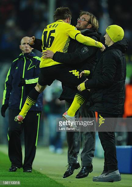 Jakub Blaszczykowski of Dortmund celebrates with head coach Juergen Klopp after scoring his teams first goal during the UEFA Champions League group F...