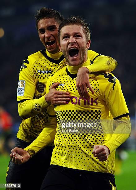 Jakub Blaszczykowski of Dortmund celebrates with team mate Moritz Leitner after scoring his teams fourth goal during the Bundesliga match between...