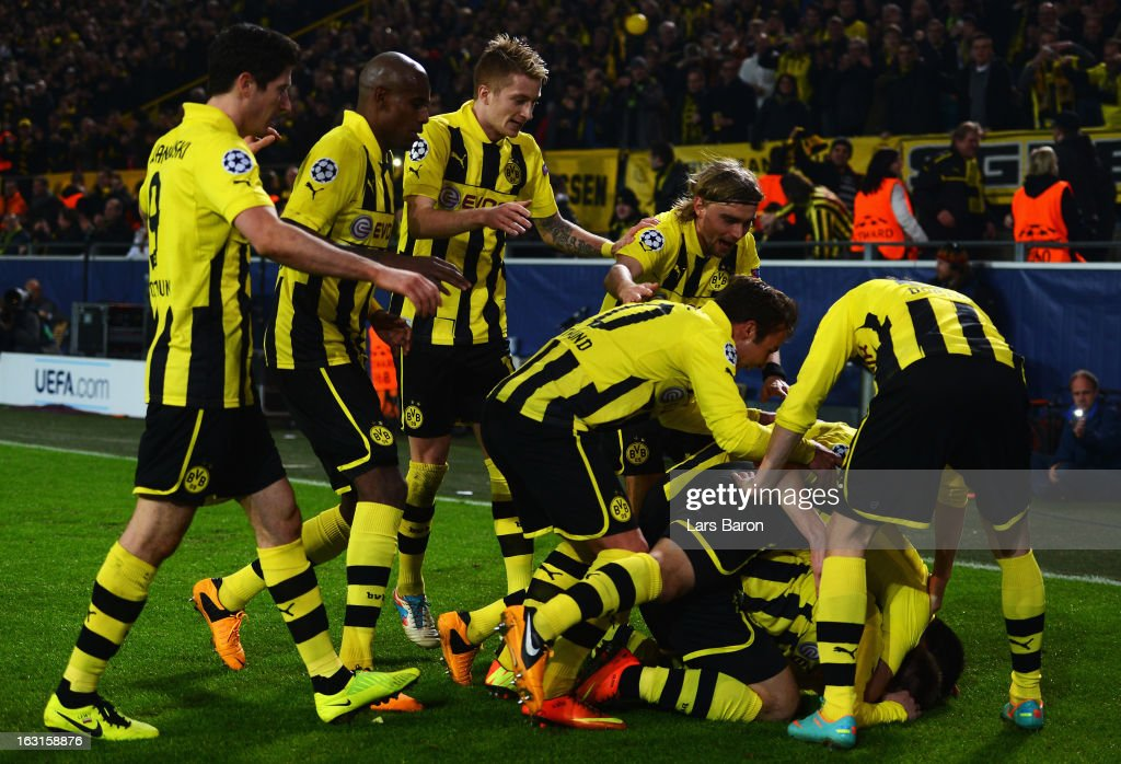 <a gi-track='captionPersonalityLinkClicked' href=/galleries/search?phrase=Jakub+Blaszczykowski&family=editorial&specificpeople=2290714 ng-click='$event.stopPropagation()'>Jakub Blaszczykowski</a> of Dortmund celebrates with team mates after scoring his teams third goal during the UEFA Champions League round of 16 second leg match between Borussia Dortmund and Shakhtar Donetsk at Signal Iduna Park on March 5, 2013 in Dortmund, Germany.
