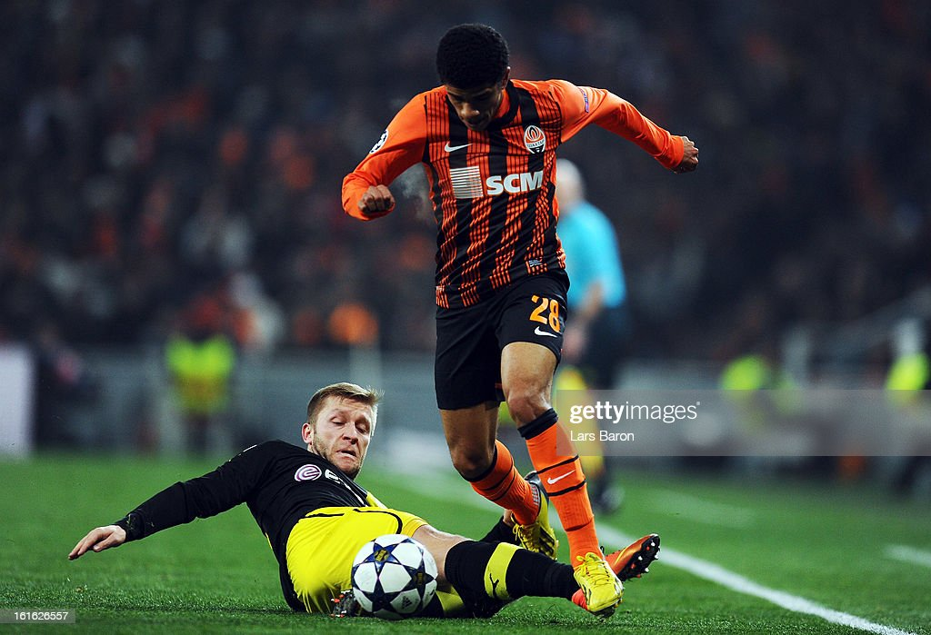 Jakub Blaszczykowski of Dortmund challenges Taison of Donetsk during the UEFA Champions League Round of 16 first leg match between Shakhtar Donetsk and Borussia Dortmund at Donbass Arena on February 13, 2013 in Donetsk, Ukraine.