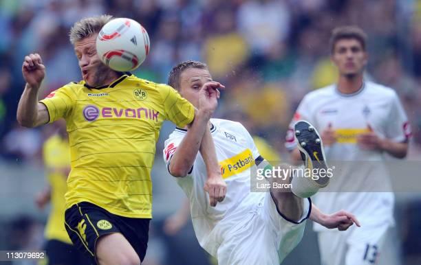 Jakub Blaszczykowski of Dortmund gets a shoot of Filip Daems of Moenchengladbach in his face during the Bundesliga match between Borussia...