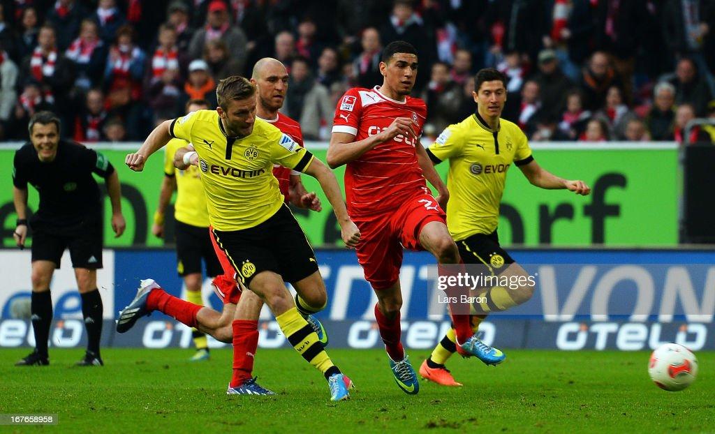 Jakub Blaszczykowski of Dortmund scores his teams second goal during the Bundesliga match between Fortuna Duesseldorf 1895 and Borussia Dortmund at...
