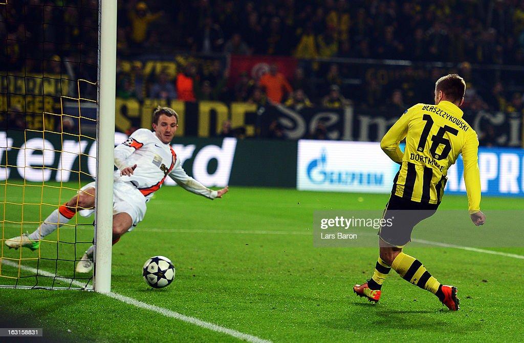 Jakub Blaszczykowski of Dortmund scores his teams third goal during the UEFA Champions League round of 16 second leg match between Borussia Dortmund...
