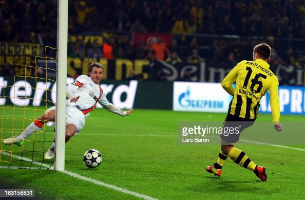 Jakub Blaszczykowski of Dortmund scores his teams third goal during the UEFA Champions League round of 16 second leg match between Borussia Dortmund...