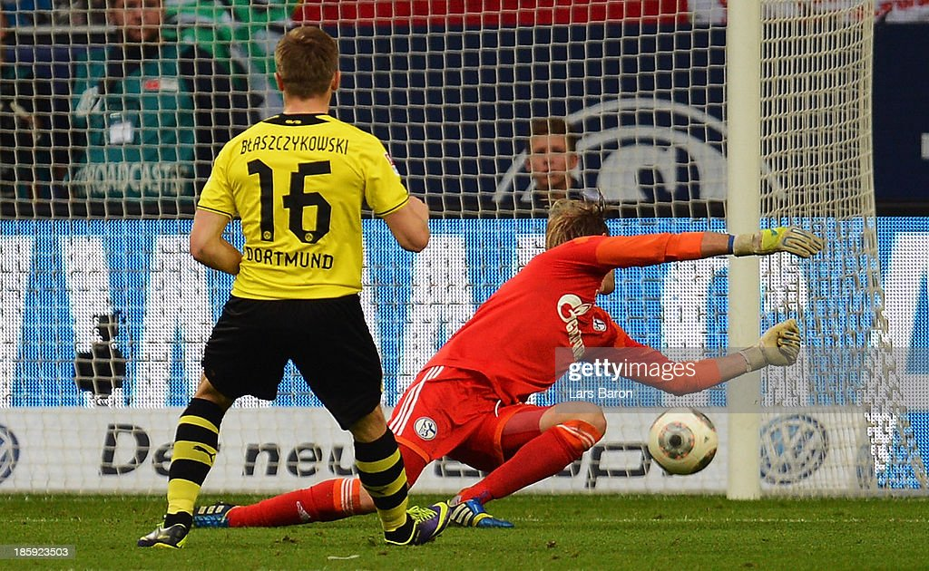 Jakub Blaszczykowski of Dortmund scores his teams third goal during the Bundesliga match between FC Schalke 04 and Borussia Dortmund at Veltins-Arena on October 26, 2013 in Gelsenkirchen, Germany.