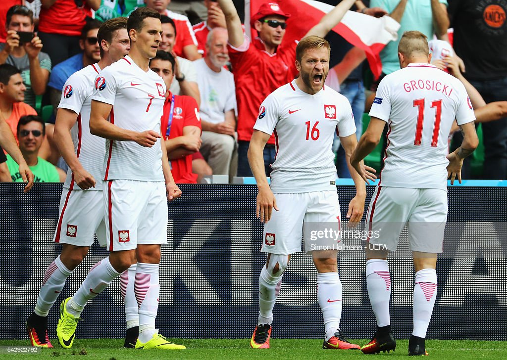 Jakub Blaszczykowski of Poland celebrates scoring his team's first goal with his team mates during the UEFA EURO 2016 round of 16 match between...