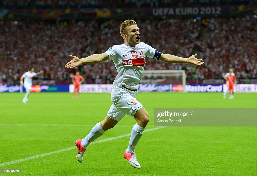 <a gi-track='captionPersonalityLinkClicked' href=/galleries/search?phrase=Jakub+Blaszczykowski&family=editorial&specificpeople=2290714 ng-click='$event.stopPropagation()'>Jakub Blaszczykowski</a> of Poland celebrates scoring their first goal during the UEFA EURO 2012 group A match between Poland and Russia at The National Stadium on June 12, 2012 in Warsaw, Poland.