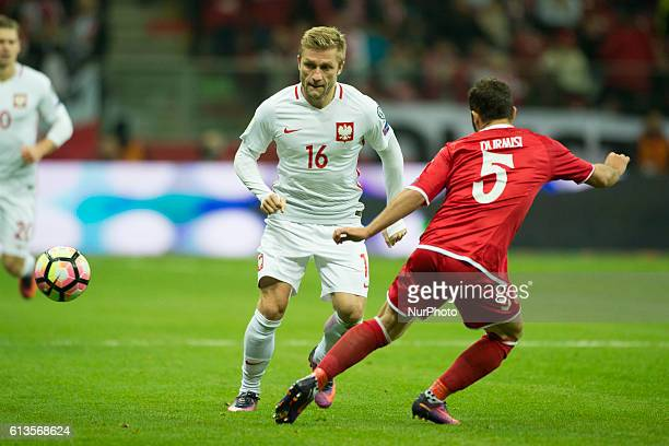 Jakub Blaszczykowski of Poland fights for the ball with Riza Durmisi of Denmark during the FIFA World Cup 2018 Qualifying Group E match between...