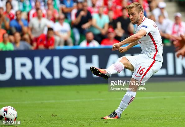 Jakub Blaszczykowski of Poland scores the opening goal during the UEFA EURO 2016 round of 16 match between Switzerland and Poland at Stade...
