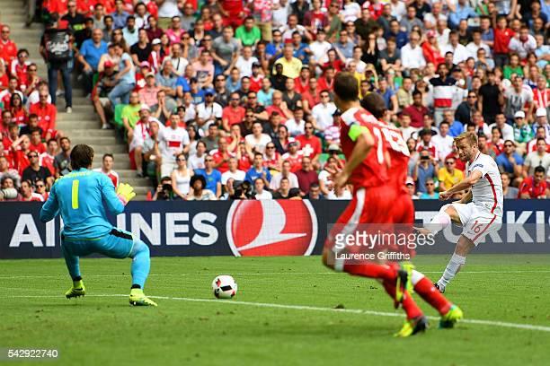 Jakub Blaszczykowski of Poland scores the opening goal past Yann Sommer of Switzerland during the UEFA EURO 2016 round of 16 match between...