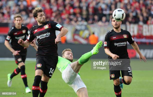 Jakub Blaszczykowski of Wolfsburg and Kevin Volland of Leverkusen and Admir Mehmedi battle for the ball during the Bundesliga match between Bayer 04...