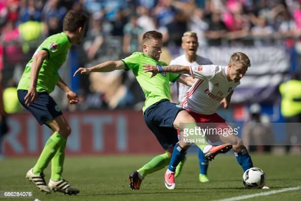 Jakub Blaszczykowski of Wolfsburg and Lewis Holtby of Hamburg battle for the ball during the Bundesliga match between Hamburger SV and VfL Wolfsburg...
