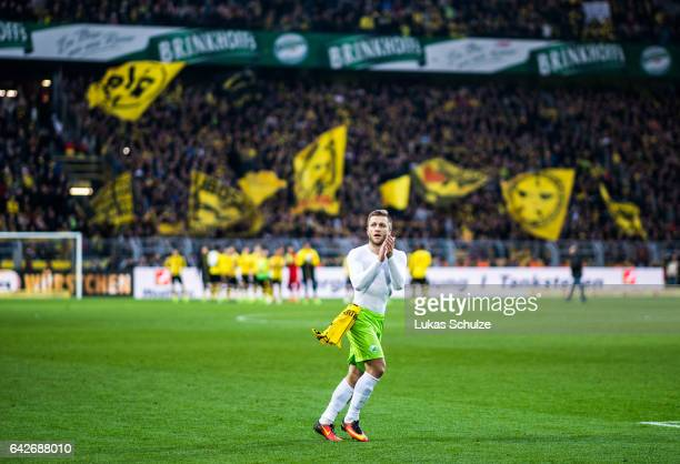 Jakub Blaszczykowski of Wolfsburg does a lap of honour after the Bundesliga match between Borussia Dortmund and VfL Wolfsburg at Signal Iduna Park on...