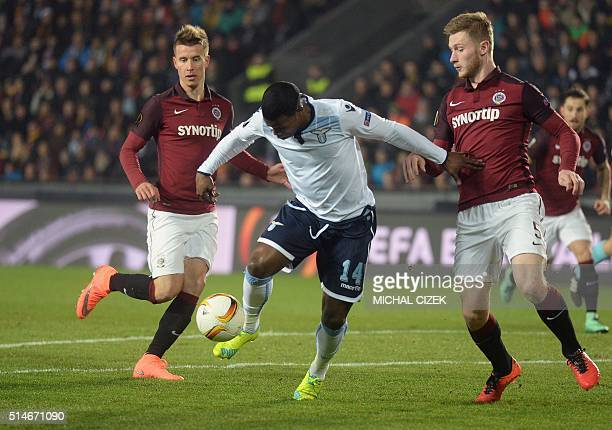 Jakub Brabec of Sparta Praha and Keita of SS Lazio vie for the ball during the UEFA Europa League Round of 16 firstleg football match between Sparta...