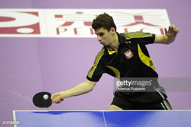 Jakub Dyjas of Poland competes against Tiago Apolonia of Portugal during the 2016 World Table Tennis Championship Men's Team Division Round 4 match...