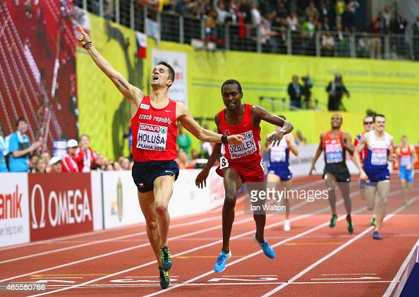 Jakub Holusa of Czech Republic crosses the line to win gold ahead of Ilham Tanui Ozbilen of Turkey in the Men's 1500 metres Final during day three of...