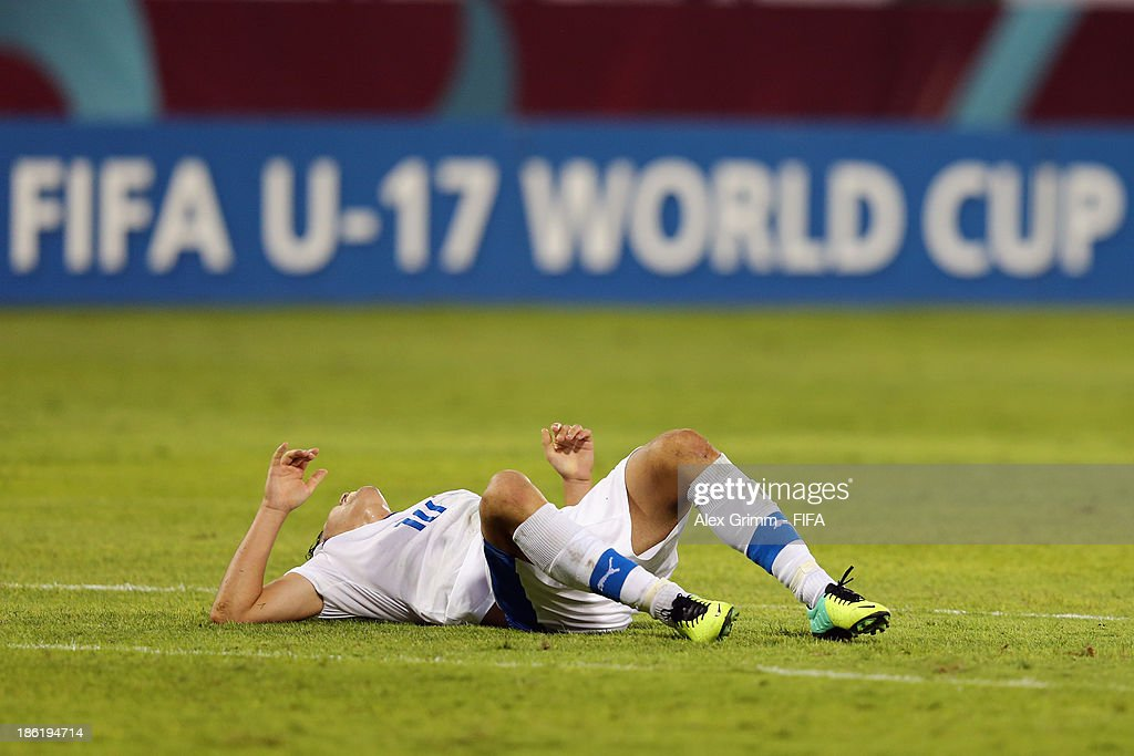 Jakub Hromada of Slovakia lies on the pitch during the FIFA U-17 World Cup UAE 2013 Round of 16 match between Uruguay and Slovakia at Ras Al Khaimah Stadium on October 29, 2013 in Ras al Khaimah, United Arab Emirates.