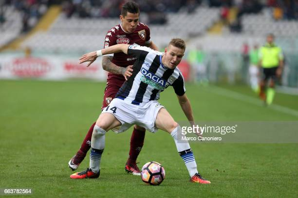 Jakub Jankto of Udinese and Manuel Iturbe of Torino Fc battle for the ball during the Serie A football match between Torino FC and Udinese Final...