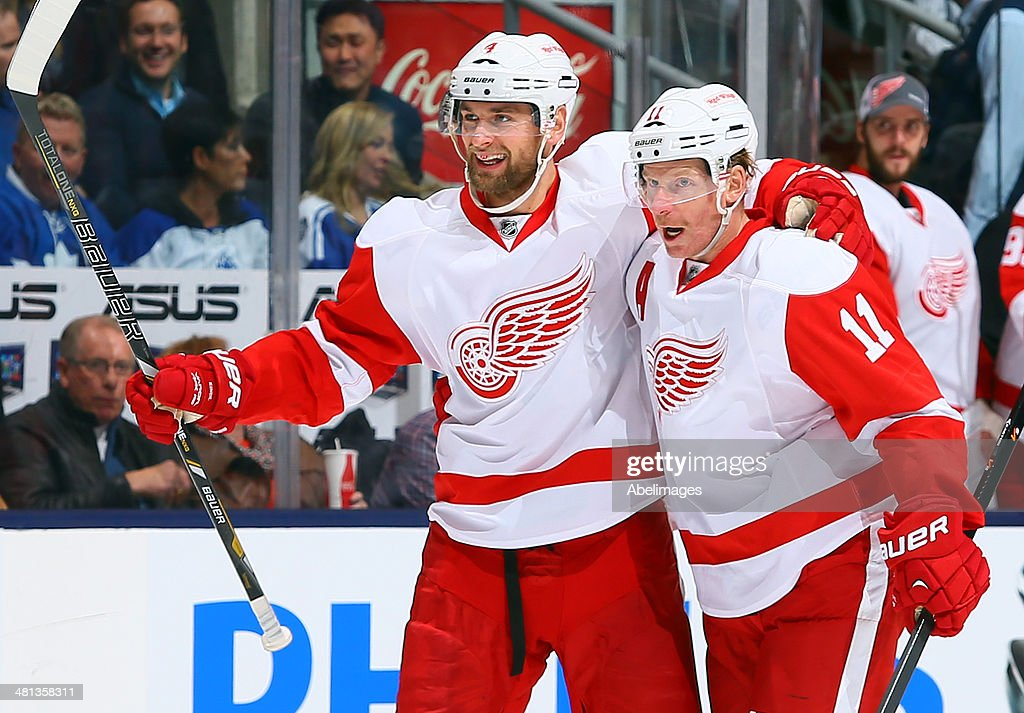 Jakub Kindl #4 and Daniel Alfredsson #11 of the Detroit Red Wings celebrate Jakub Kindl goal of the Toronto Maple Leafs during NHL action at the Air Canada Centre march 29, 2014 in Toronto, Ontario, Canada.