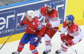 Jakub Kindl and Michal Jordan of Czech Republic watchs the puck with Martin Roymark of Norway during the 2014 IIHF World Championship between Czech...